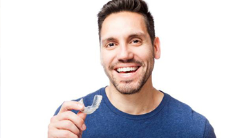 Man holding clear aligner