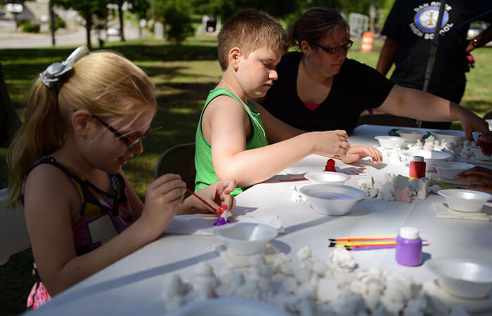 Children doing crafts outdoors
