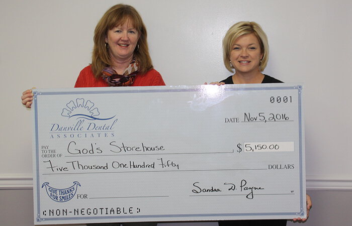 Large charity check to God's Storehouse for $5,150.00