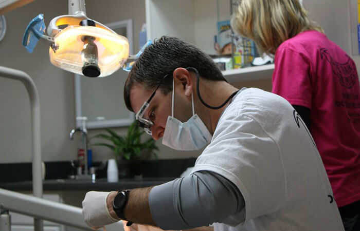 Dr. Payne volunteering dental work on a patient