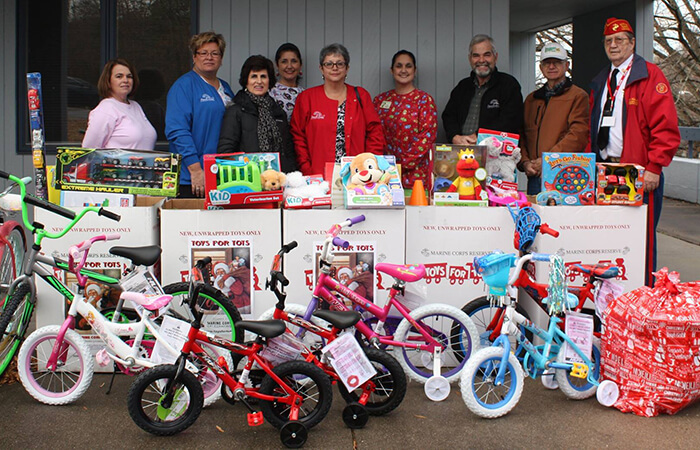 Dr. Albert Payne and his Toys for Tots crew taking a photo with their donations