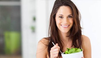 Happy woman with salad