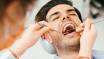 Dentist working on male patient