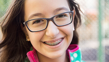 Danville Orthodontics young girl smiling wearing braces