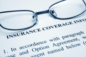 dental insurance documents and glasses