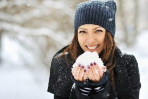 Woman smiling with snow