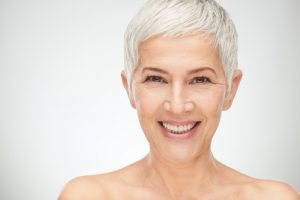 older woman smiling with silver hair