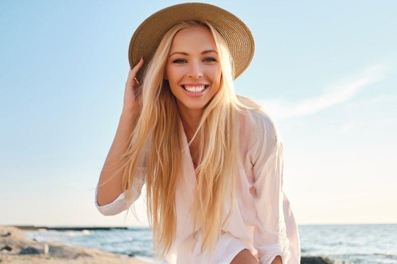 girl smiling at beach during summer vacation